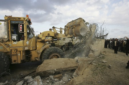 Photo of the demolition of  a similar wall in Gaza by Khalil Hamra/AP, ripped from Time.com.